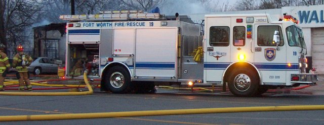 Fort Worth working a fire at a Haltom City Garage - 3/28/2002